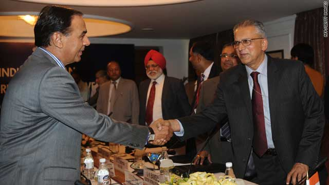 Pakistan's Interior Secretary Qamar Zaman Chaudhry (left) shakes hands with his Indian counterpart G.K. Pillai.