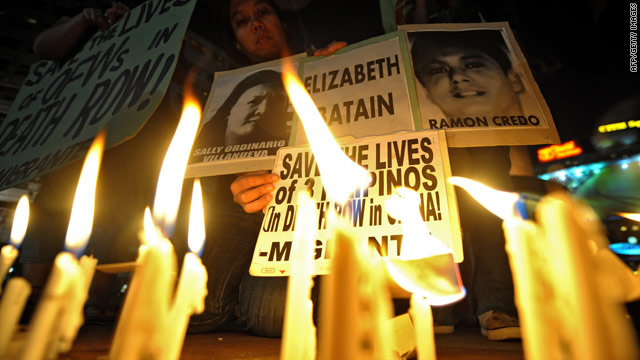 A protester lights a candle during a vigil appealing to the Chinese government to stop the execution of three Filipinos and commute their death sentences on humanitarian grounds in Quezon City, the Phlilippines, on March 24.