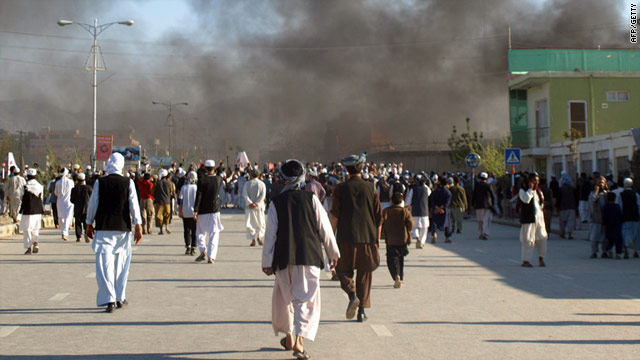Smoke rises from the U.N. building in Mazar-e Sharif on Friday where 12 people died of violence, including eight U.N. staffers.