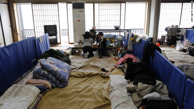 A family group from Fukushima at a makeshift shelter in Yokote city, Akita prefecture.