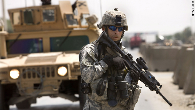 An American soldier stands guard near the site of a suicide bomb attack aimed at the U.S.-led coalition on July 31, 2007 in Kabul.