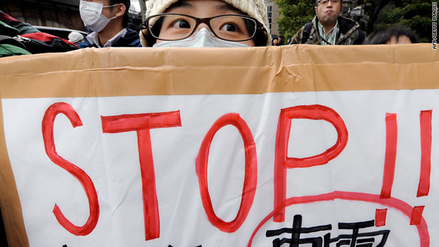Demonstrators outside the Tokyo Electric Power Company building in Tokyo on Sunday call for an end to nuclear power.