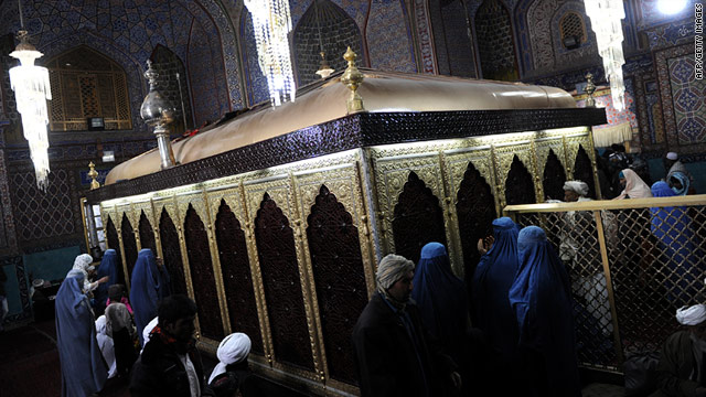 Afghans pray inside the Hazrat-i Ali shrine in Mazar-i-Sharif where an angry mob stormed a U.N. compound on April 1.