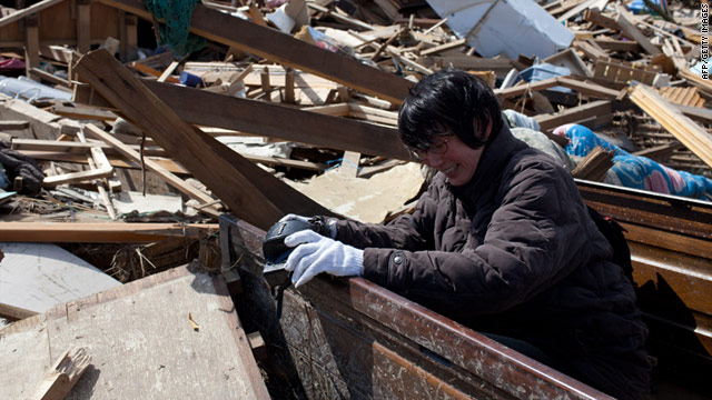 Chieko Matsukawa finds her camera in her shattered home in Miyagi Prefecture, where personal items lie amid miles of rubble.
