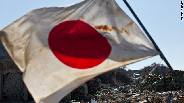 A Japanese flag stands amid the devastation of the tsunami in the town centre of Onagawa, Miyagi prefecture, on April 6, 2011.
