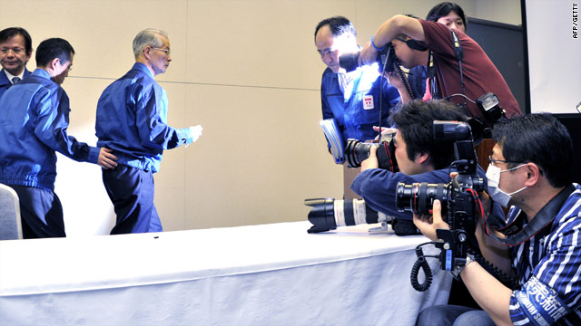 "Tepco boss Tsunehisa Katsumata, third from left, says it could take nine months for reactors to achieve ""cold"" shutdown."