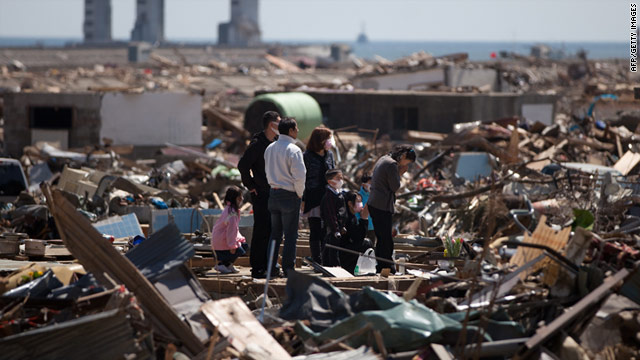 The death toll from Japan's earthquake and tsunami has risen to 13,843 people -- and 136,481 have been displaced, say police.