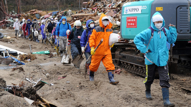 Volunteers arrive to clean up tsunami generated debris at the Whale and Ocean Science Museum in Yamada town, Iwate prefecture on April 16, 2011.