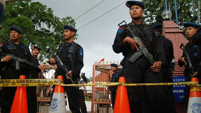 Indonesian officers outside the police station in the city of Cirebon after the suicide attack last Friday.