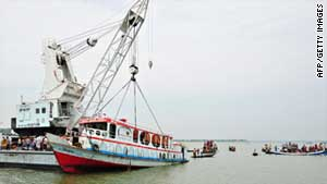 Rescue workers recover a passenger ferry which sank in Bangladesh.