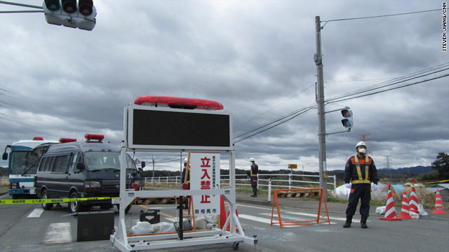 Police guard a checkpoint in Minamisoma, Japan, just outside  the 20km exclusion zone.