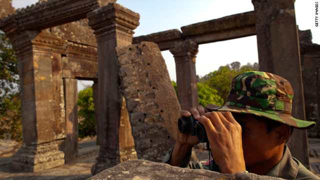A Cambodian solider looks across at the Thai border from the Preah Vihear temple on February 9.