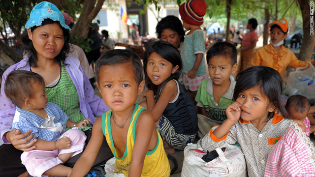 Cambodian children who live near the Thai-Cambodia border and were evacuated after cross border fighting rest at a pagoda in Oddar Meanchey province on April 23.
