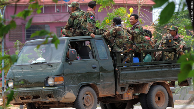 Cambodian soldiers travel in a military truck along a street near the border with Thailand on Monday.