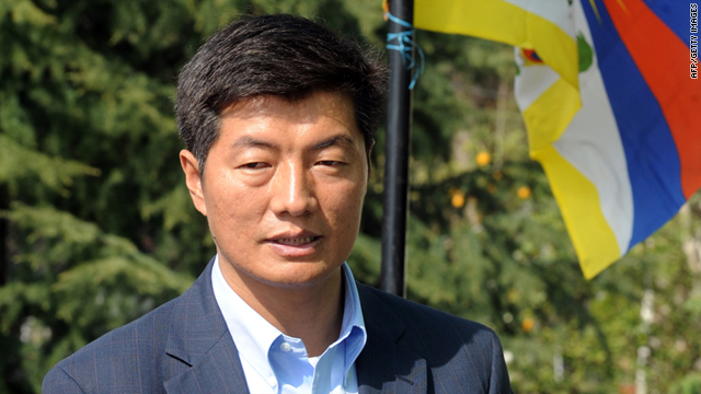 Lobsang Sangay stands by a Tibetan flag during his election campaign in Dharamshala on March 18, 2011.