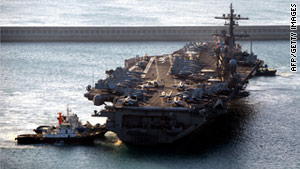 The religious rites were conducted on the deck of the USS Carl Vinson in the Arabian Sea.