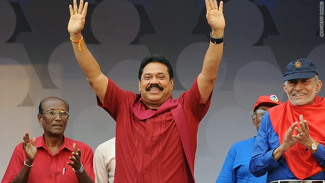 Sri Lankan President Mahinda Rajapaksa, center, waves during a rally in Colombo on Sunday.