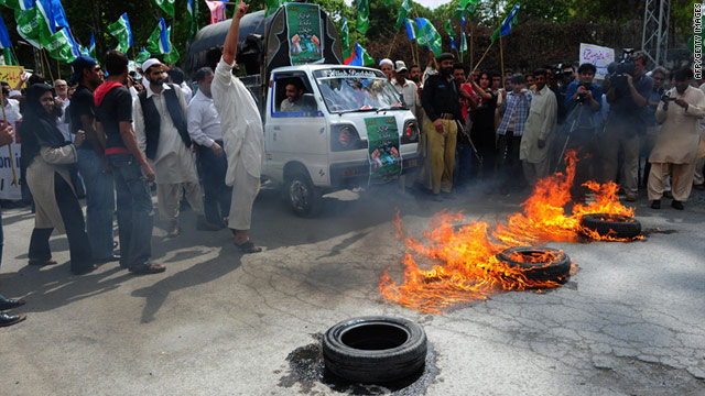 Protesters burn tires Friday at a rally organized by the Jamrat-E-Islami party in Abbottabad, Pakistan, to condemn the U.S raid.
