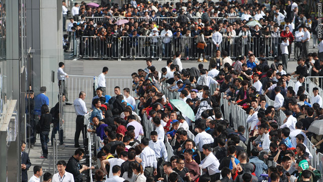 People queue to buy iPad 2 at an Apple store on May 6 in Beijing, China.