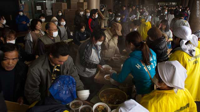 Earthquake victims line up for food at an evacuation shelter in Japan's Fukushima City on April 9, 2011.