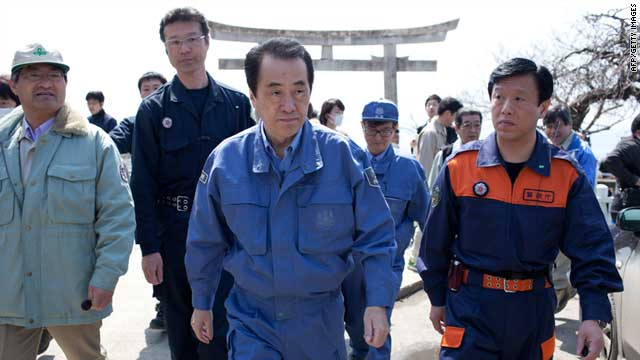 Japanese Prime Minister Naoto Kan (center)  visiting the tsunami-hit area of Ishinomaki in Miyagi prefecture on April 10, 2011.