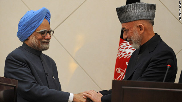 Afghan President Hamid Karzai, right, holds a press conference with Indian Prime Minister Manmohan Singh on Thursday.