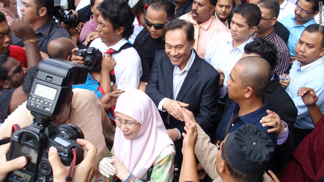 Anwar Ibrahim, center, has repeatedly claimed the trial is an attempt to derail his political career.