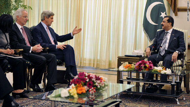 Yousuf Raza Gilani (R) listens to John Kerry (3L) during a meeting at the Prime Minister's house in Islamabad on Monday.