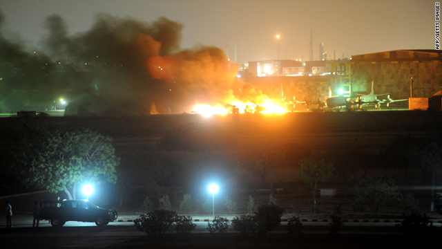 Flames and smokes erupt from the military air base after the attack by militants in Karachi on Sunday.