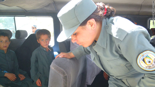 Policemwoman Sgt. Pari Gul searches a car at a key checkpoint outside Kabul, Afghanistan -- challenging insurgents and perceptions.