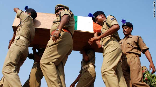 Police officials carry a coffin of a colleague on April 8, 2010, after his death in a Maoist attack in Chhattisgarh.