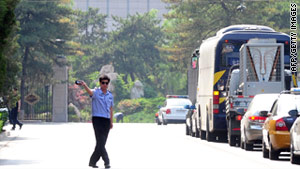 A policeman stops media from filming the Diaoyutai State Guesthouse for visiting dignitaries in Beijing Wednesday.