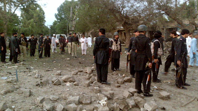 Pakistani security personnel gather at the site of a suicide car bomb attack in the town of Hangu on Thursday.
