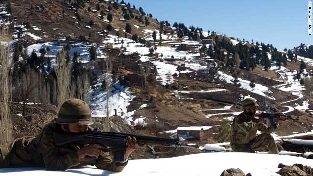 Pakistani soldiers take position at the military check post of Pash Ziarat, a town of North Waziristan, on March 8, 2011.