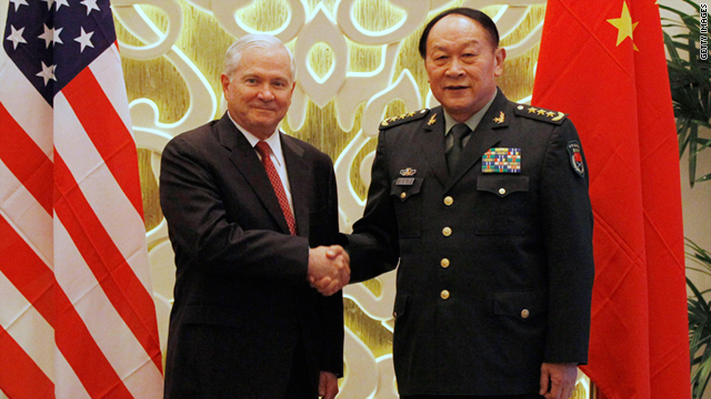 Robert Gates shakes hands with China's Defence Minister Liang Guanglie at the Asia Security Summit on Friday in Singapore.