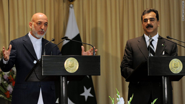 Pakistani Prime Minister Yousuf Raza Gilani, right, and Afghani President Hamid Karzai speak at a joint press conference.