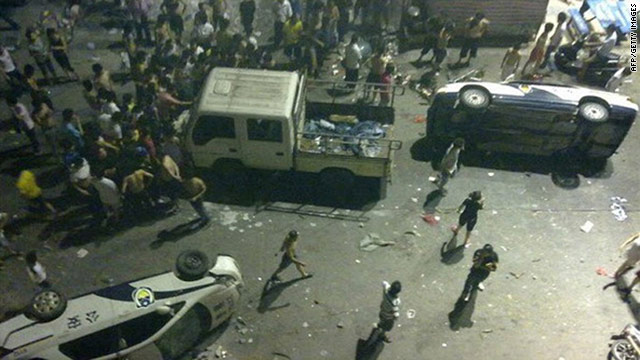 A photo dated June 12 shows damaged police cars overturned by protesters in Xintang, China.
