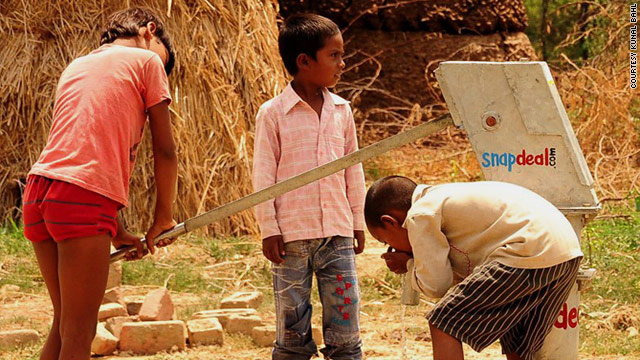 Children of SnapDeal.com Nagar use one of the hand pumps donated to their village.