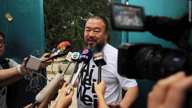 Outspoken Chinese artist Ai Weiwei speaks to reporters outside his studio in Beijing Thursday.