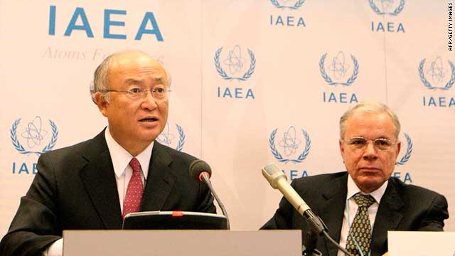 Yukiya Amano (left) speaks to the press Friday on the last day of the conference on nuclear safety in Vienna, Austria.
