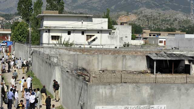 People gather outside the compound of al Qaeda leader Osama bin Laden in Abbottabad, Pakistan, on May 3, 2011.