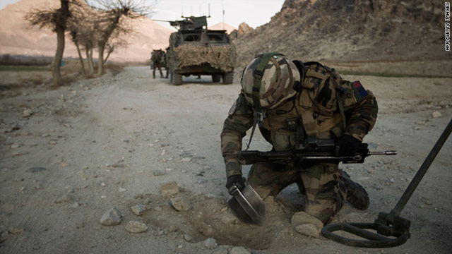 A mine clearing specialist from the French Foreign Legion searches for improvised explosive devices on a road on January 25.