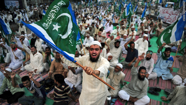 An activist protests against U.S. drone attacks during a rally in Karachi, Pakistan, on June 4.
