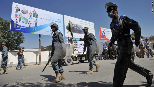 Afghani policemen patrol during a demonstration in Kabul on July 2.