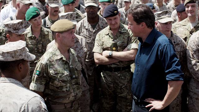 British Prime Minister David Cameron visits troops Monday in Helmand province. A British soldier also was found dead Monday.