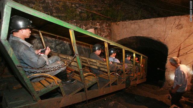 Rescuers make their way into a mine in Guangxi on July 2, where three bodies at the site were recovered.