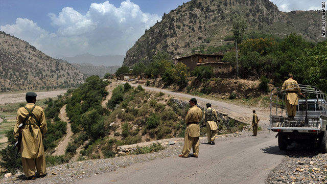 Pakistani soldiers patrol along a street in north western Kurram tribal district close to the Afghan border on July 6, 2010.