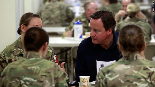 British Prime Minister David Cameron has breakfast with troops after making a speech at Camp Leatherneck on July 4.