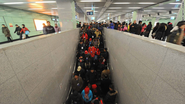 Passengers exit a subway station in Beijing in December 2010. One person was killed in an escalator accident Tuesday.