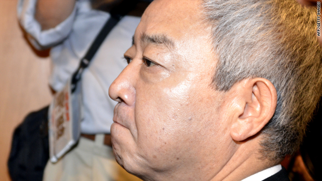 Ryu Matsumoto leaves a press conference after announcing his resignation at his office in Tokyo on Tuesday.